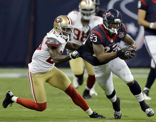 San Francisco 49ers' Chris Culliver, left, hangs onto the shirttail of Houston Texans' Arian Foster (23) in the first quarter an NFL preseason football game Saturday, Aug. 18, 2012, in Houston. (AP Photo/David J. Phillip) Photo: David J. Phillip, Associated Press