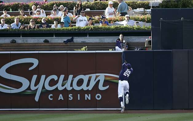 SAN DIEGO, CA - AUGUST 18 - Cameron Maybin #24 of the San Diego Padres leaps at the wall but cannot catch the ball hit in the 5th inning of the game against the San Francisco Giants at Petco Park on August 18, 2012 in San Diego, California. (Photo by Kent C. Horner/Getty Images) Photo: Kent Horner, Getty Images