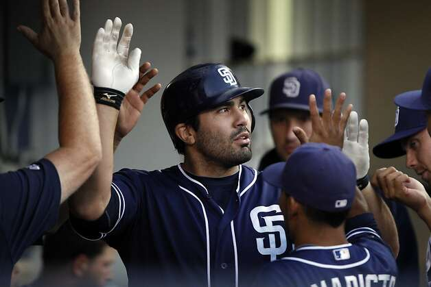 San Diego Padres' Carlos Quentin, center, gets congratulations from teammates after hitting a solo home run against the San Francisco Giants during the sixth inning of a baseball game in San Diego, Saturday, Aug. 18, 2012. (AP Photo/Alex Gallardo) Photo: Alex Gallardo, Associated Press