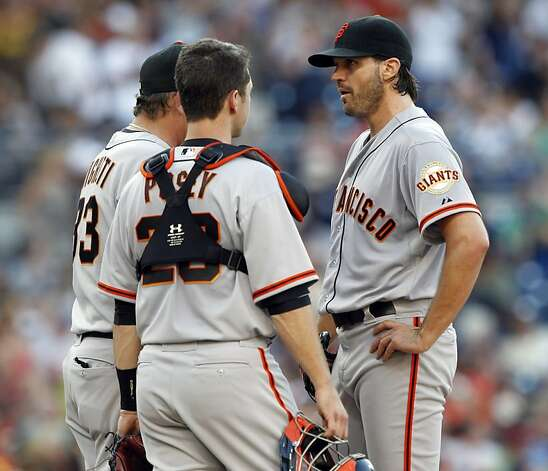 San Francisco Giants starting pitcher Barry Zito (75) talks with pitching coach Dave Righetti, left, and catcher Buster Posey after giving up a three-run home run to the San Diego Padres' Chase Headley during the third inning of a baseball game in San Diego, Saturday, Aug. 18, 2012. (AP Photo/Alex Gallardo) Photo: Alex Gallardo, Associated Press