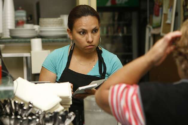 Lisseth Luna taking an order at cafe and restaurant Montecristo in San Francisco , Calif., on Monday, August  13, 2012. Photo: Liz Hafalia, The Chronicle
