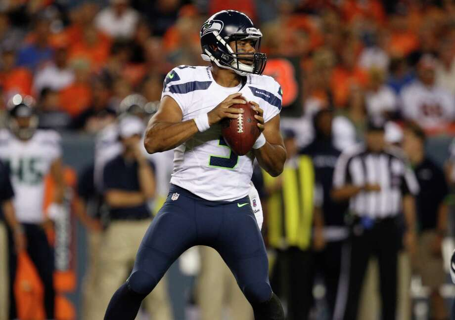 Seattle Seahawks quarterback Russell Wilson looks to pass against the Denver Broncos in the second half. Photo: AP