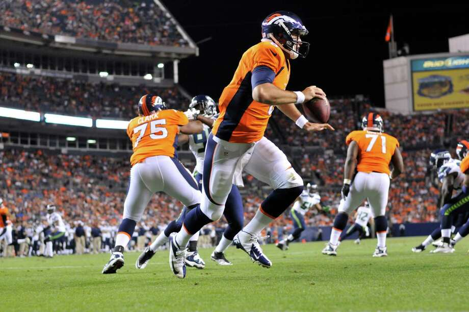 Denver Broncos'  Brock Osweiler drops to pass against the Seattle Seahawks in the second half. Photo: AP