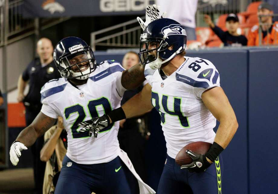 Seattle Seahawks' Cooper Helfet (84) celebrates his touchdown against the Denver Broncos with teammate  Kregg Lumpkin (20), in the second half. The Seahawks beat the Broncos, 30-10. Photo: AP