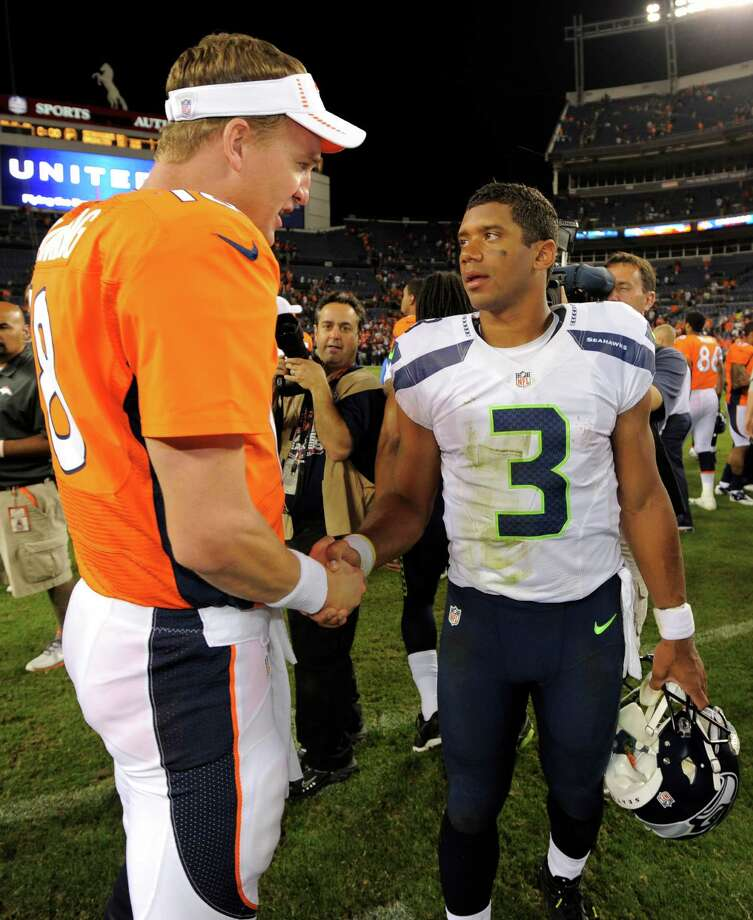 Denver Broncos quarterback Peyton Manning (18) shakes hands with Seattle Seahawks quarterback Russell Wilson (3) following an NFL football preseason game, Saturday, Aug. 18, 2012, in Denver. Seattle beat Denver 30-10. Photo: AP