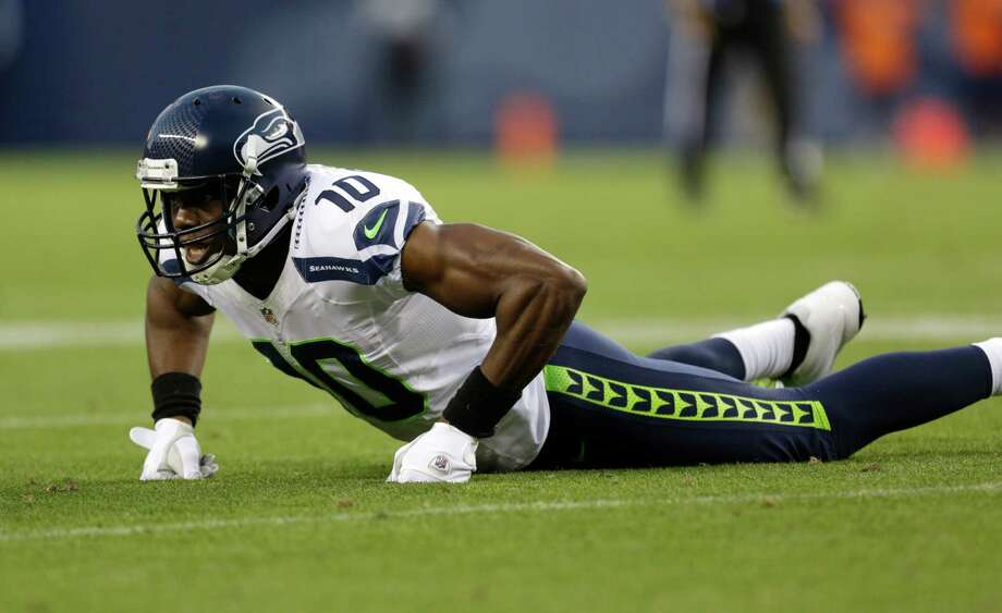 Seattle Seahawks wide receiver Terrell Owens gets up after missing a catch in the first half. Photo: AP