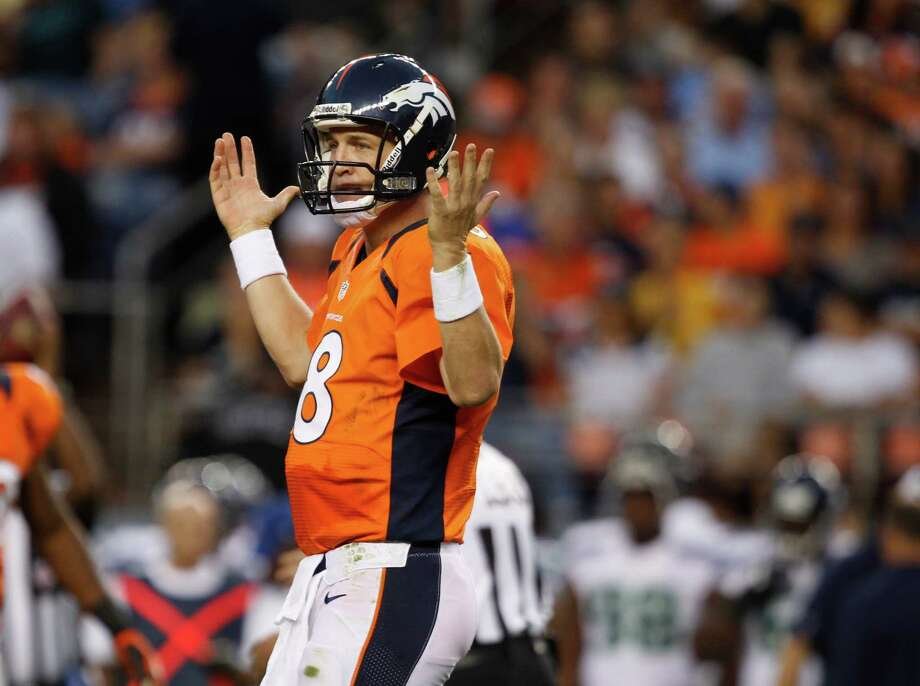 Denver Broncos quarterback Peyton Manning reacts in the first half. Photo: AP