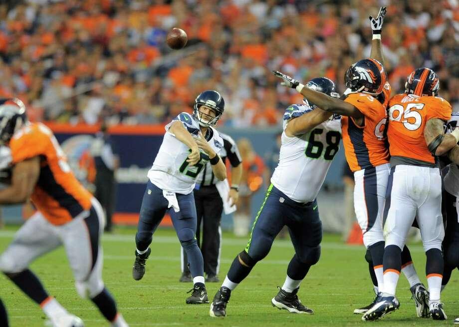 Seattle Seahawks quarterback Matt Flynn passes against the Denver Broncos, in the first half. Photo: AP