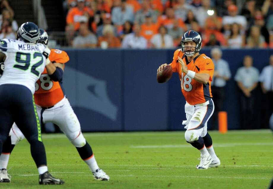 Denver Broncos quarterback Peyton Manning looks to throw in the first half. Photo: AP