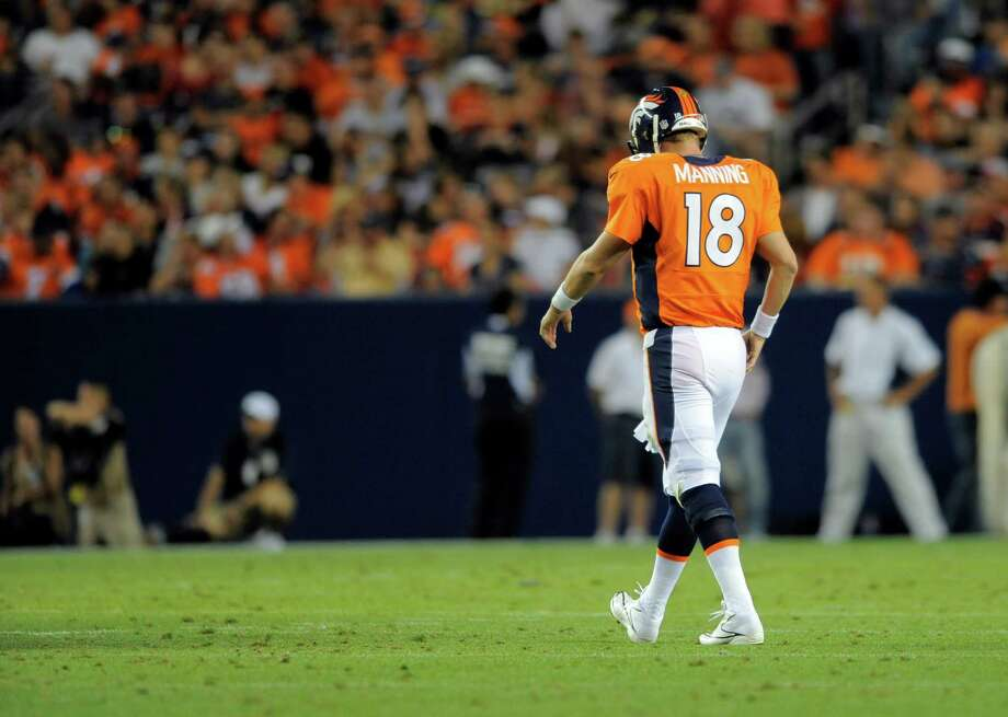 Denver Broncos quarterback Peyton Manning hangs his head against the Seattle Seahawks in the first half. Photo: AP