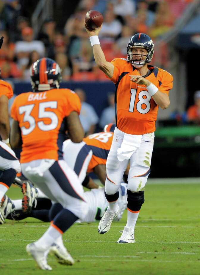 Denver Broncos quarterback Peyton Manning (18) throws to Lance Ball (35) in the first half. Photo: AP