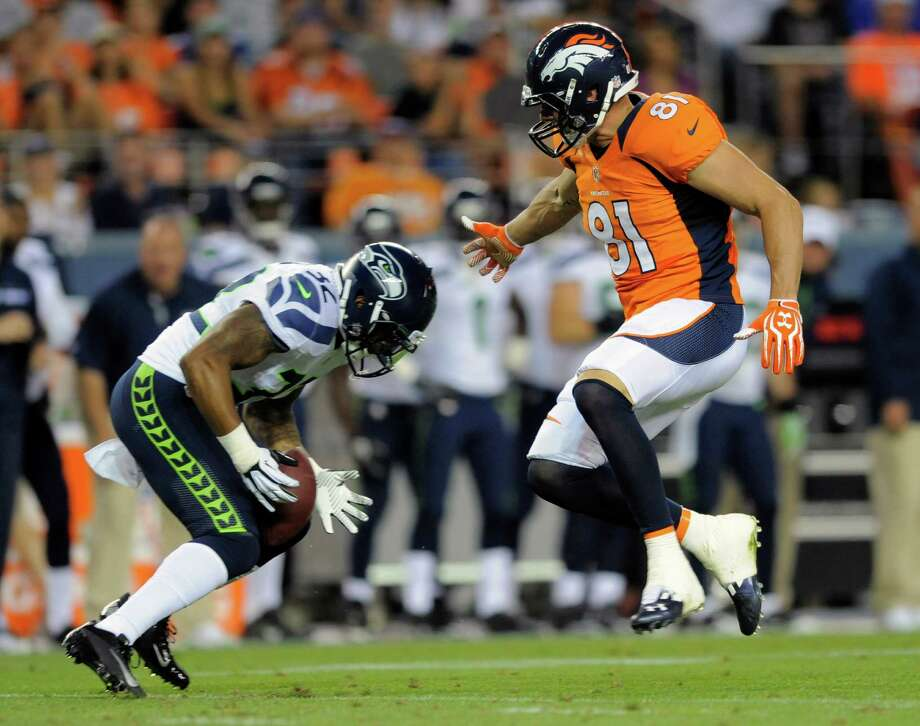 Seattle Seahawks defensive back Jeron Johnson (32) intercepts a pass intended for Denver Broncos tight end Joel Dreessen (81). Photo: AP