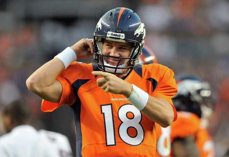 Denver Broncos quarterback Peyton Manning  reacts after his team scored a touchdown in the first hal