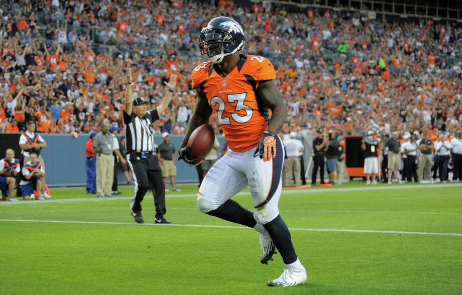 Denver Broncos' Willis McGahee scores a touchdown against the Seattle Seahawks, in the first half. Photo: AP