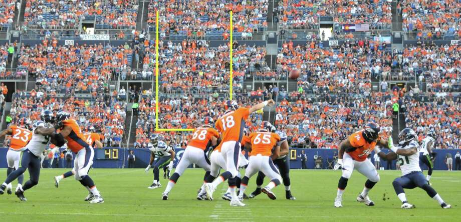 Denver Broncos quarterback Peyton Manning (18) passes against the Seattle Seahawks in the first half. Photo: AP