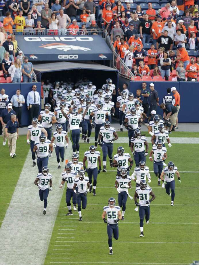 The Seattle Seahawks take the field for an NFL football preseason game against the Denver Broncos, Saturday, Aug. 18, 2012, in Denver. Photo: AP