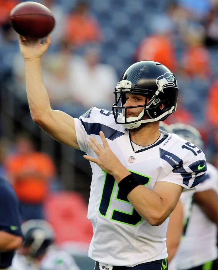 Seattle Seahawks quarterback Matt Flynn passes during warmups. Photo: AP