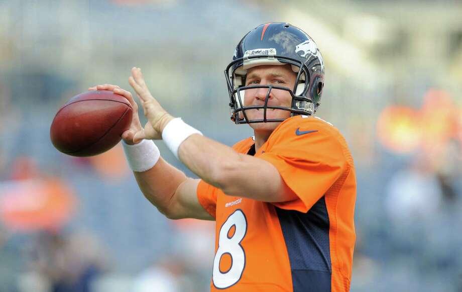 Denver Broncos quarterback Peyton Manning passes during warmups. Photo: AP