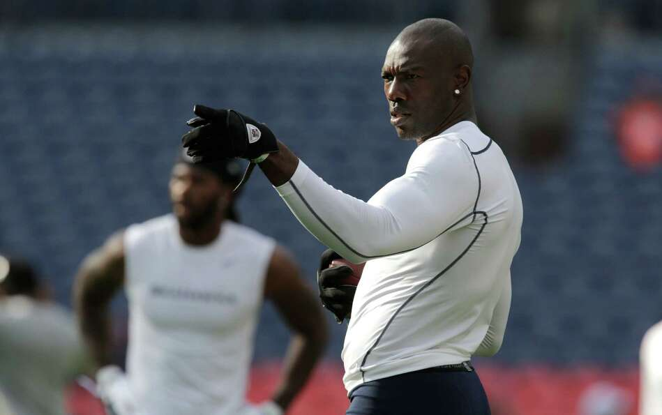 Seattle Seahawks' Terrell Owens gestures during warmups before an NFL football exhibition game again