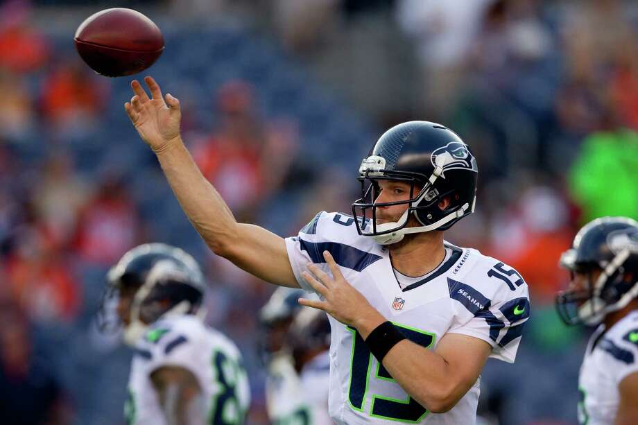 Quarterback Matt Flynn #15 of the Seattle Seahawks warms up on the field before taking on the Denver Broncos. Photo: Justin Edmonds, Getty Images / 2012 Getty Images