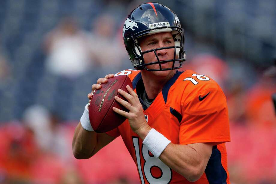 Quarterback Peyton Manning #18 of the Denver Broncos warms up on the field before a pre-season game against the Seattle Seahawks. Photo: Justin Edmonds, Getty Images / 2012 Getty Images