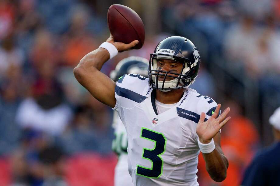 Quarterback Russell Wilson #3 of the Seattle Seahawks warms up on the field before a pre-season game against the Denver Broncos. Photo: Justin Edmonds, Getty Images / 2012 Getty Images