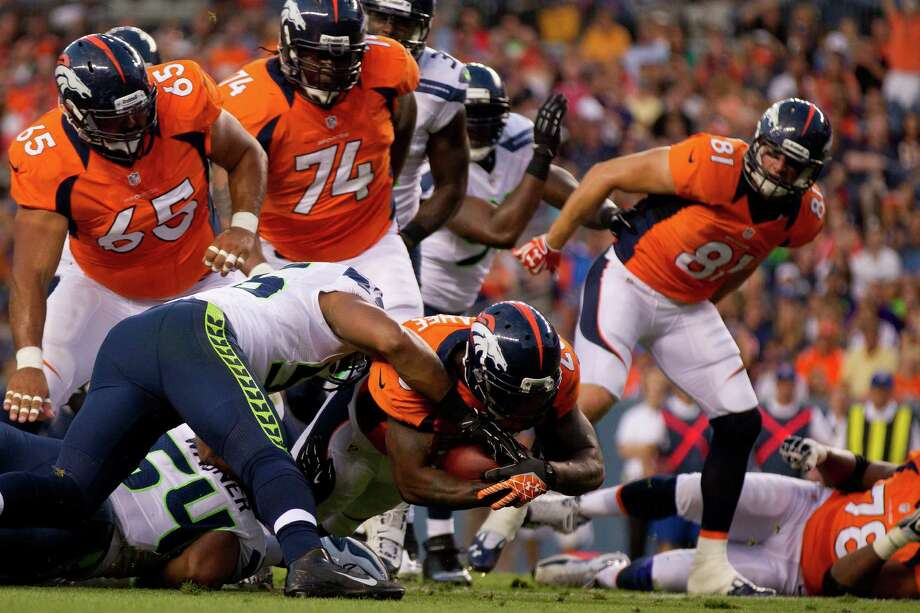 Running back Willis McGahee #23 of the Denver Broncos scores a touchdown on a two yard run during the first quarter against the Seattle Seahawks. Photo: Justin Edmonds, Getty Images / 2012 Getty Images