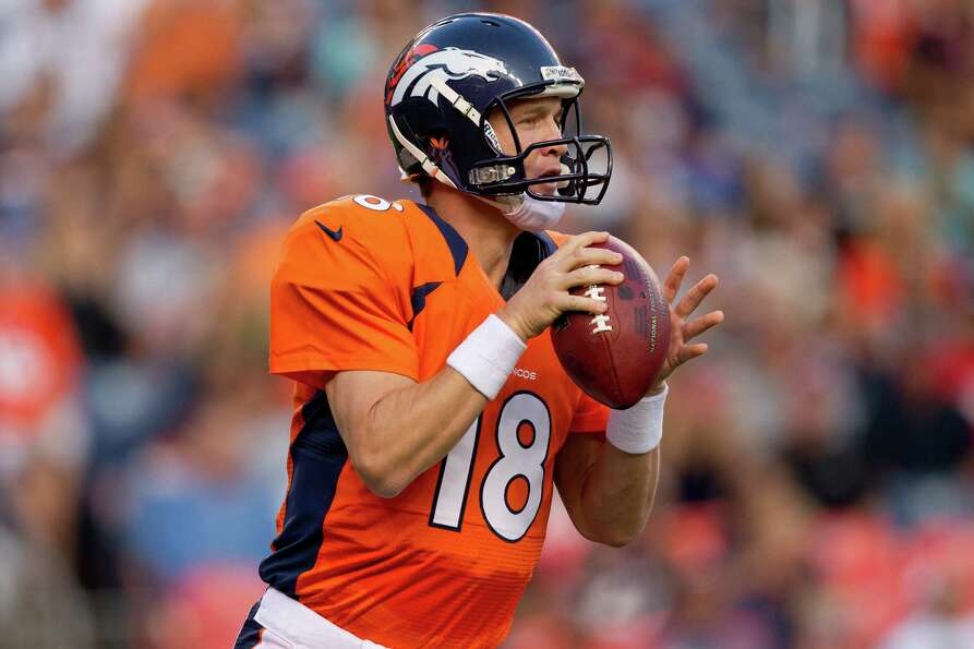 Quarterback Peyton Manning #18 of the Denver Broncos looks to pass during the first quarter against