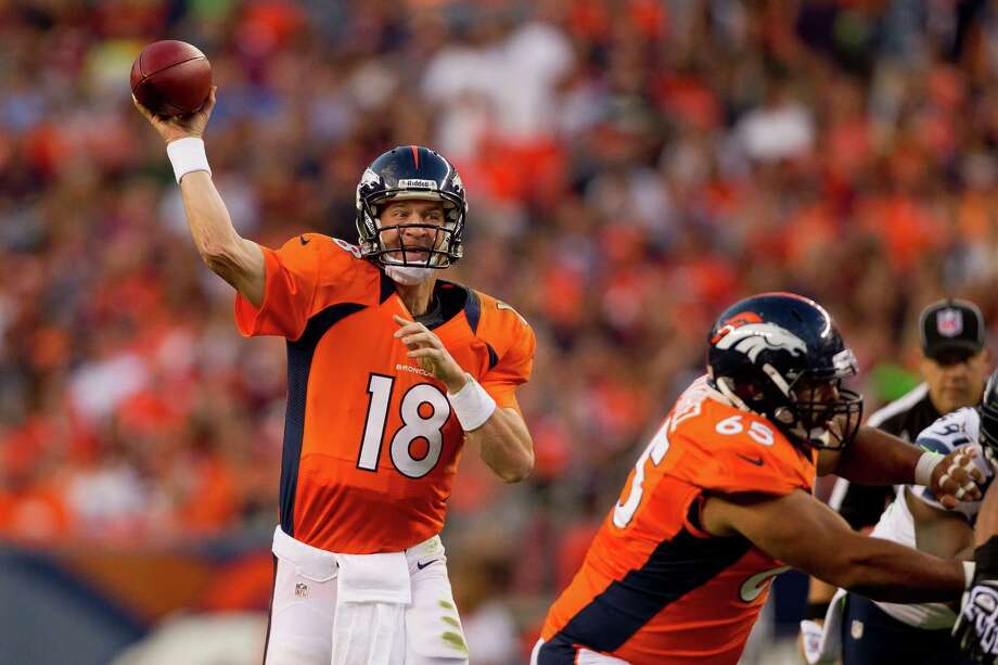 Quarterback Peyton Manning #18 of the Denver Broncos throws a pass during the first quarter against the Seattle Seahawks. Photo: Justin Edmonds, Getty Images / 2012 Getty Images
