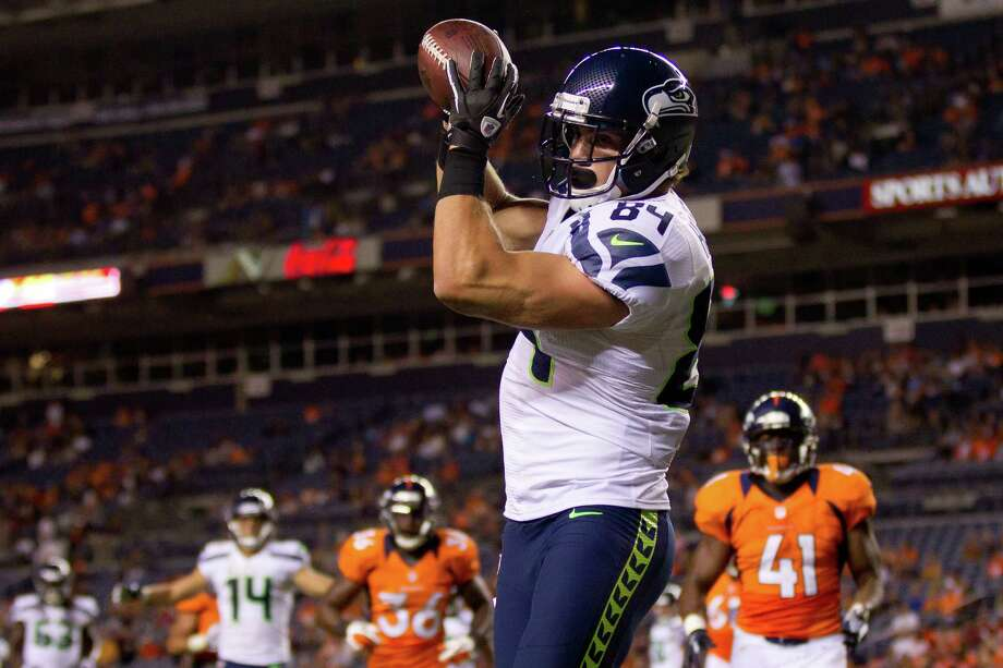 Cooper Helfet #84 of the Seattle Seahawks makes a reception for a 9-yard touchdown during the fourth quarter against the Denver Broncos. The Seahawks defeated the Broncos 30-10. Photo: Justin Edmonds, Getty Images / 2012 Getty Images