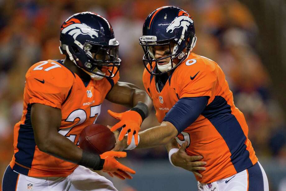 Quarterback Brock Osweiler #6 of the Denver Broncos hands the ball off to running back Knowshon Moreno #27 during the third quarter against the Seattle Seahawks. The Seahawks defeated the Broncos 30-10. Photo: Justin Edmonds, Getty Images / 2012 Getty Images