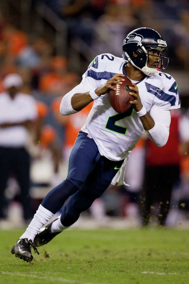 Quarterback Josh Portis #2 of the Seattle Seahawks rolls out to pass during the fourth quarter against the Denver Broncos. The Seahawks defeated the Broncos 30-10. Photo: Justin Edmonds, Getty Images / 2012 Getty Images