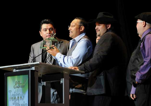 The members of Tejano Highway 281 accept their award for best new group during the Tejano Music Awards at the Alamodome on Saturday, Aug. 18, 2012. Photo: Billy Calzada, San Antonio Express-News / © 2012 San Antonio Express-News