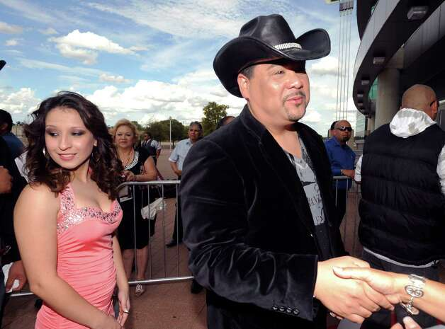 David Olivarez, right, and his conga player, Mimi Perez, arrive for the Tejano Music Awards at the Alamodome on Saturday, Aug. 18, 2012. Photo: Billy Calzada, San Antonio Express-News / © 2012 San Antonio Express-News