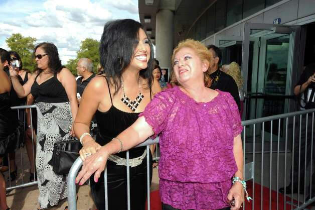 Mary Munoz, right, is excited to meet singer Monica Castro during the Tejano Music Awards at the Alamodome on Saturday, Aug. 18, 2012. Photo: Billy Calzada, San Antonio Express-News / © 2012 San Antonio Express-News
