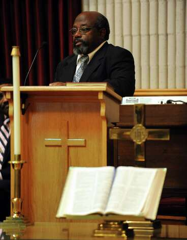 John Harris Jr. speaks during services for his father, John Harris Sr., at The Grace Baptist Church in Norwalk on Saturday, August 18, 2012. Photo: Lindsay Niegelberg / Stamford Advocate
