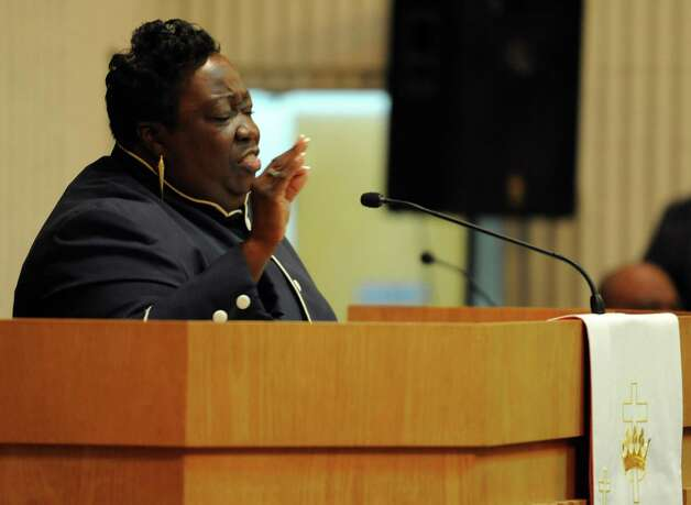 Reverend Sonya Merrill-Williams speaks during services for John Harris Sr. at The Grace Baptist Church in Norwalk on Saturday, August 18, 2012. Photo: Lindsay Niegelberg / Stamford Advocate