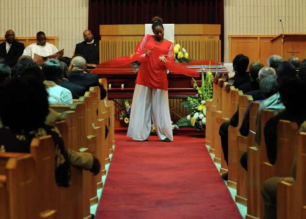 A praise dancer performs during services for John Harris Sr. at The Grace Baptist Church in Norwalk on Saturday, August 18, 2012. Photo: Lindsay Niegelberg / Stamford Advocate
