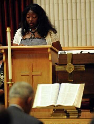 Ashley Harris reads from Corinthians during services for her grandfather, John Harris Sr. at The Grace Baptist Church in Norwalk on Saturday, August 18, 2012. Photo: Lindsay Niegelberg / Stamford Advocate