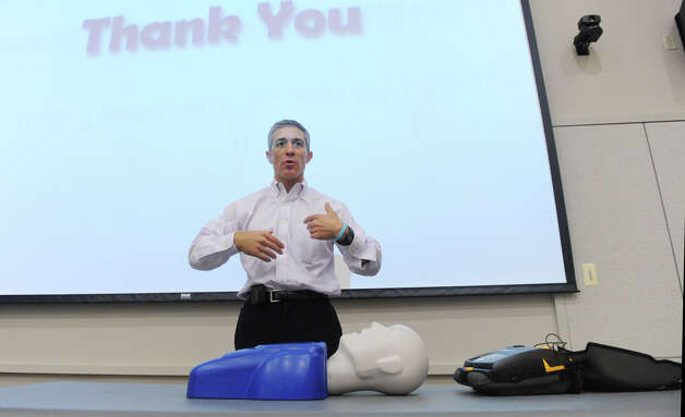 "Dr. Thomas Nero conducts a training session for the upcoming Hands for Life event at the Tully Center in Stamford, Conn., August 15, 2012.  Hands for Life will take place at Chelsea Piers Saturday, August 25 The goal for the event is to train 10,000 people how to provide cardiopulmonary resuscitation. Earlier in the evening, State Rep. Gerald Fox was given the first ""Hands for Life"" award for his long time support of ""Good Samaritan"" laws to indemnify those who administer CPR. Photo: Keelin Daly / Stamford Advocate"