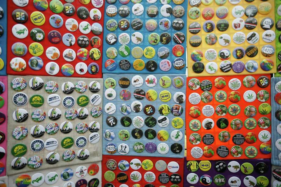 Various buttons are shown on a vendor's board. Photo: Sofia Jaramillo / SEATTLEPI.COM