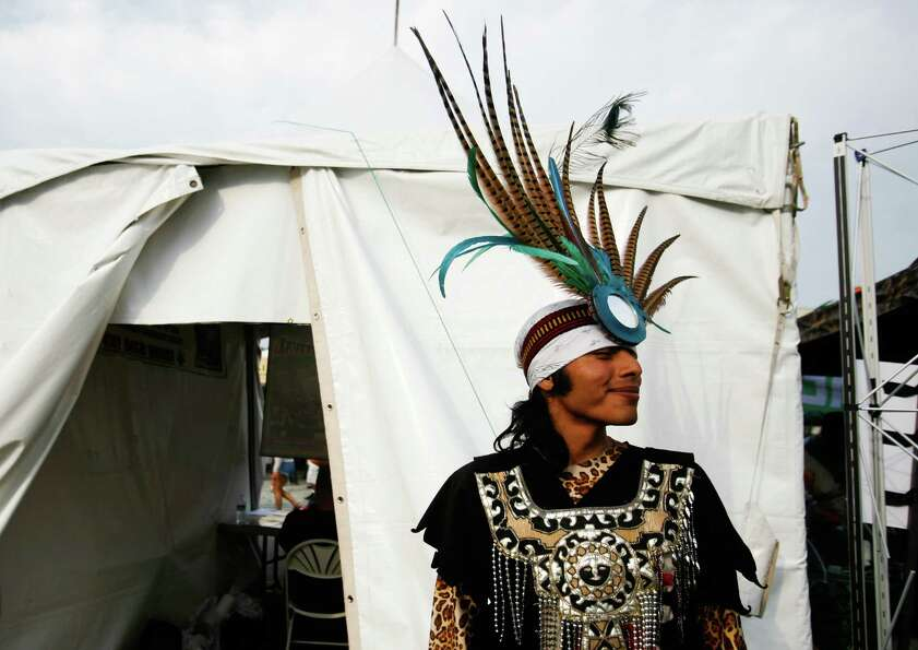 Alejandro Islas wears a traditional headdress after performing.
