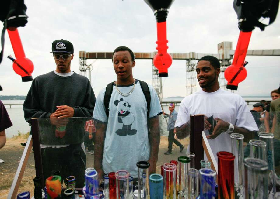 (Far Right) Jamell Stagg and friends check out a display at a booth. Photo: Sofia Jaramillo / SEATTLEPI.COM