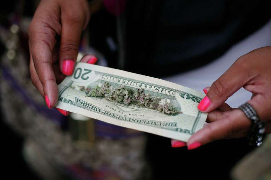 Marijuana is shown on a $20 bill. Photo: Sofia Jaramillo / SEATTLEPI.COM