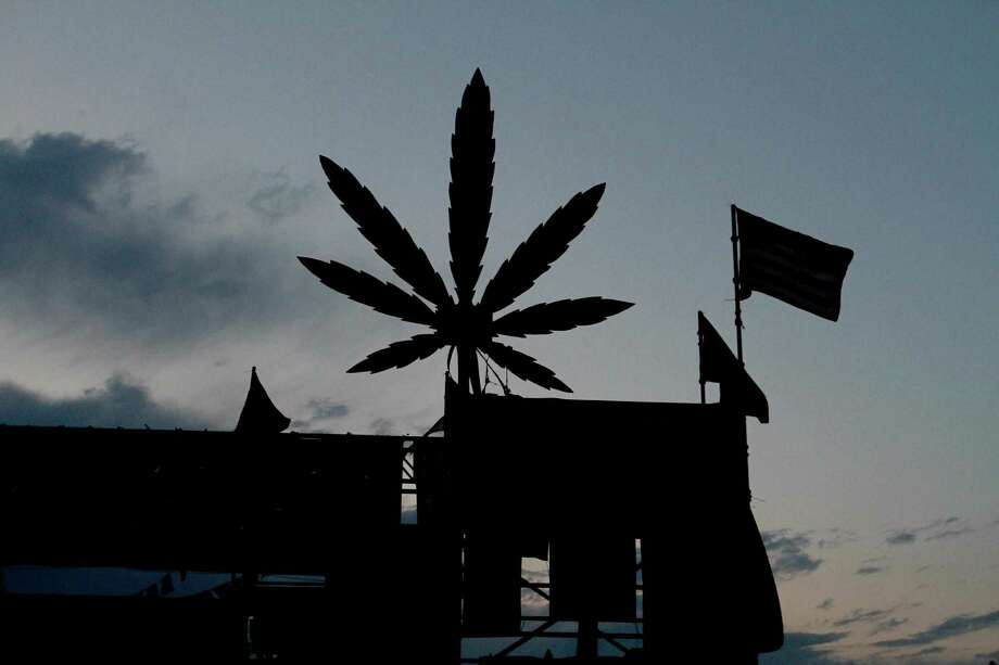 A marijuana leaf cutout is shown on top of a stage. Photo: Sofia Jaramillo / SEATTLEPI.COM