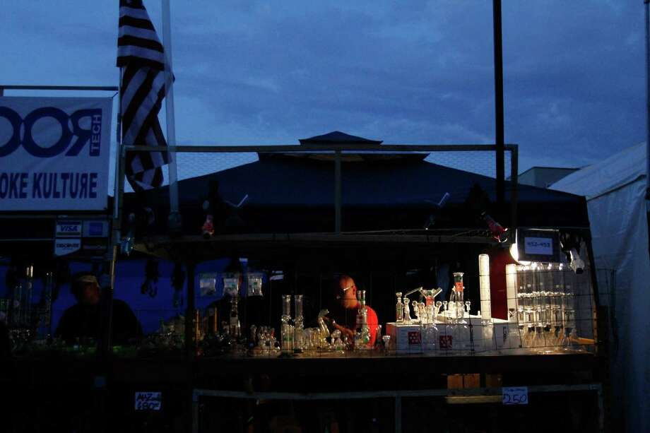 Sergey Leonitiva prepares to close up his  shop as the sun sets. Photo: Sofia Jaramillo / SEATTLEPI.COM