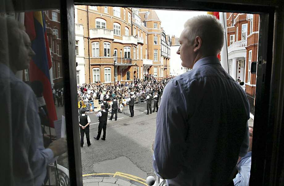 WikiLeaks founder Julian Assange stands on a balcony at the Ecuadoran Embassy in London, where has sought sanctuary in his extradition battle. Photo: Sean Dempsey, Associated Press