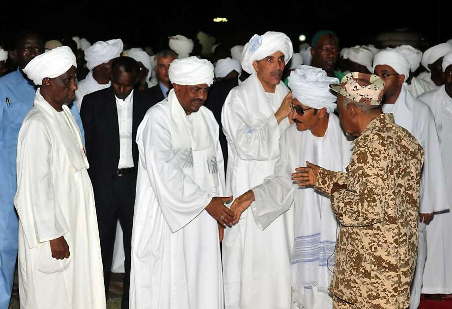 Sudanese President Omar Bashir (C) accepts condolences in Khartoum on August 19, 2012, after cabinet minister was among 32 politicians, generals and others killed when a plane crashed on its way to Sudan's war-torn South Kordofan state for the start of Muslim holidays, state media and an aviation official said. AFP PHOTO/EBRAHIM HAMIDEBRAHIM HAMID/AFP/GettyImages Photo: Ebrahim Hamid, AFP/Getty Images