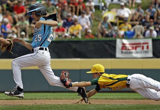 Petaluma, Calif., second baseman Porter Slate (6) dives to make the tag on Goodlettsville, Tenn.'s Brock Myers (25) to end a rundown between second and third during the second inning of a baseball game during Little League World Series pool play in South Williamsport, Pa., Sunday, Aug. 19, 2012. Goodlettsville won 9-6. (AP Photo/Gene J. Puskar) Photo: Gene J. Puskar, Associated Press