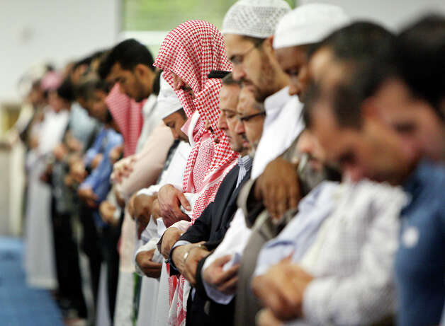 Men and boys pray during Eid al-Fitr, the end of Ramadan, Sunday Aug. 19, 2012 at the Islamic Center of San Antonio's new mosque. Ramadan is the monthlong fast by Muslims from food, drink, and marital relations from dawn to sunset. Photo: Edward A. Ornelas, San Antonio Express-News / © 2012 San Antonio Express-News
